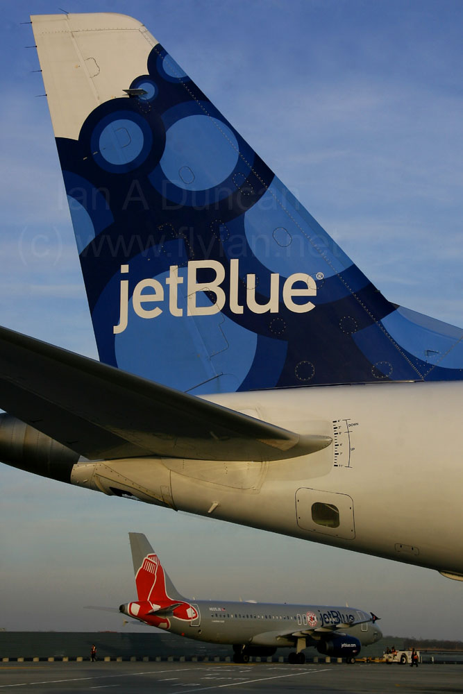JetBlue Embraer E-190 tail and Red Sox Airbus A-320 at JFK