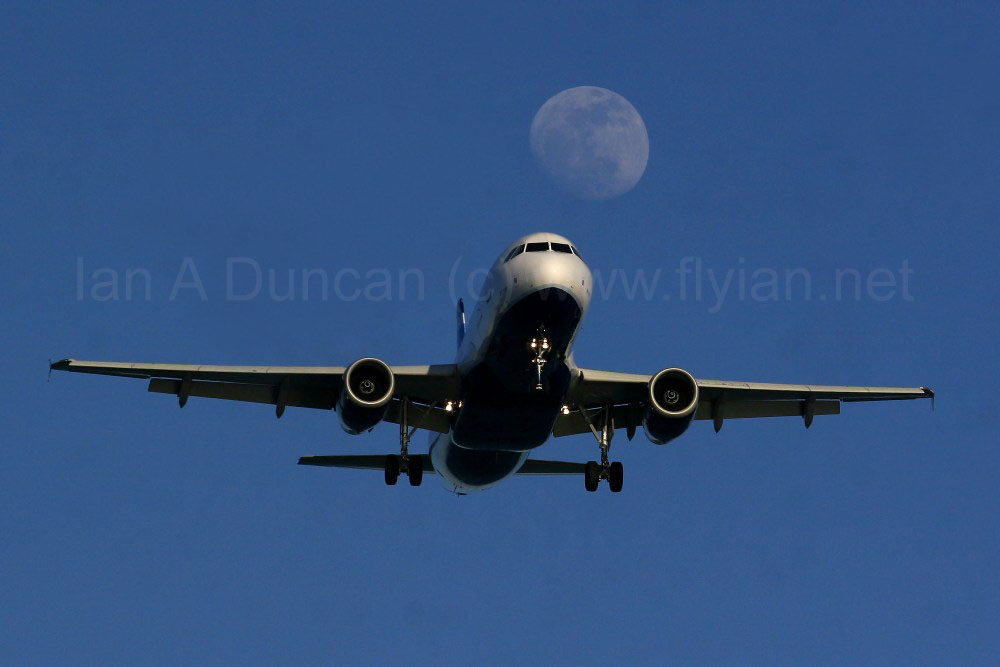 JetBlue Airbus A-320 and rising moon