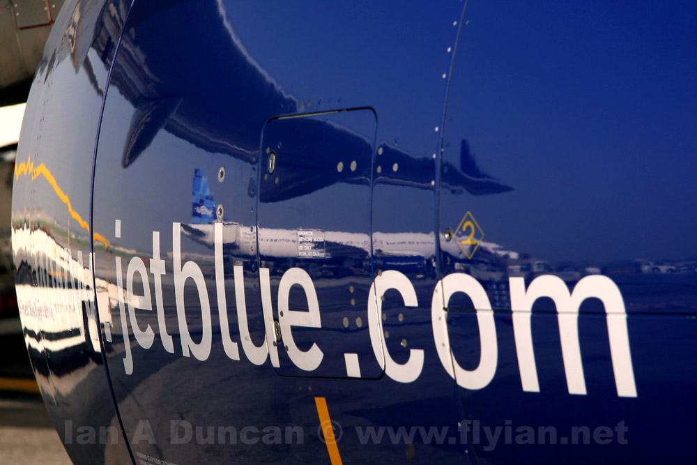 JetBlue A320 reflected in E190 engine nacelle
