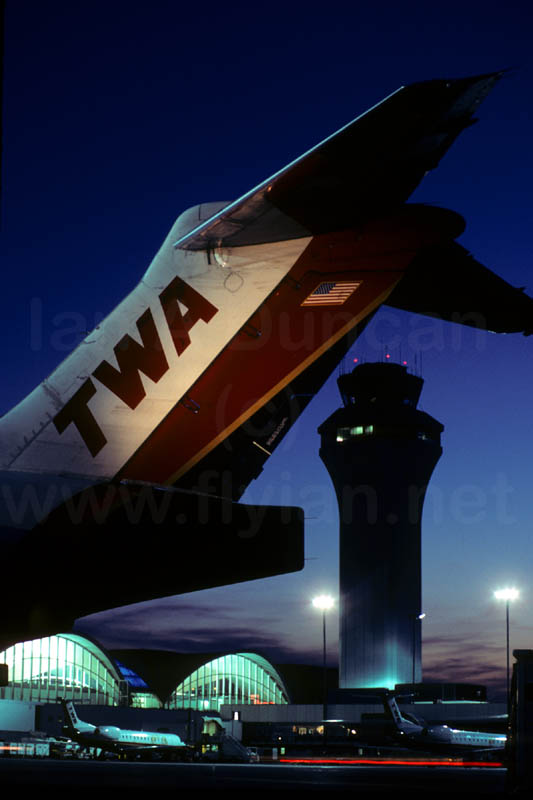 TWA MD-80 tail, STL Tower at sunset